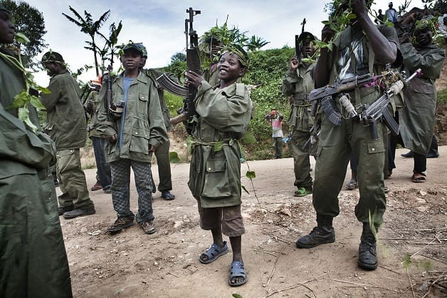 A child soldier of the Mai Mai in Kanyabayonga during an offensive against the CNDP